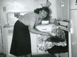 1956 Mom making Thanksgiving turkey